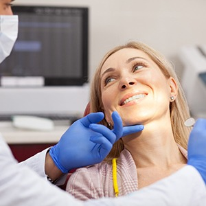 Woman in dental chair during dental consultation.