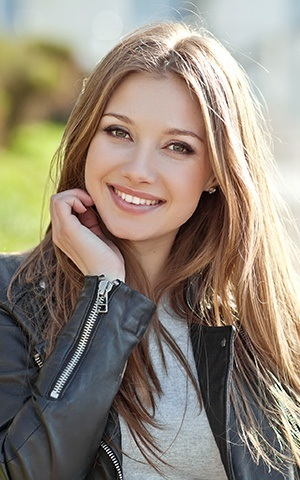 model smiling in moto jacket