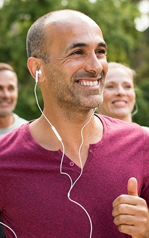 man running with headphones in