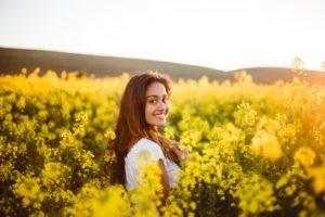 woman smiling in field