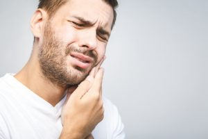 Man in need of an emergency dentist in Costa Mesa
