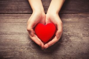 Heart in hands for American Heart Health Month