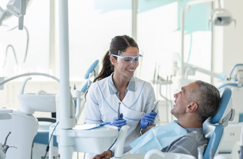 Dentist in Costa Mesa talking to patient